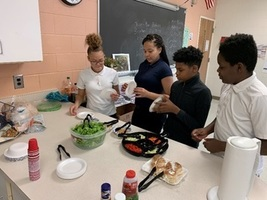 EIGHTH GRADERS PREPARE HEALTHY FOODS FROM USING HYDROPONICS TABLE