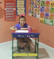 Cali is busy working in her home school room on the first day of school.