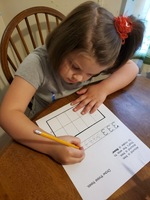Jenni Lunsford busy working on numbers at home.