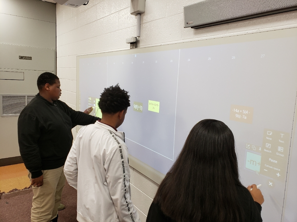 The Nureva Board allows students to work math problems simultaneously