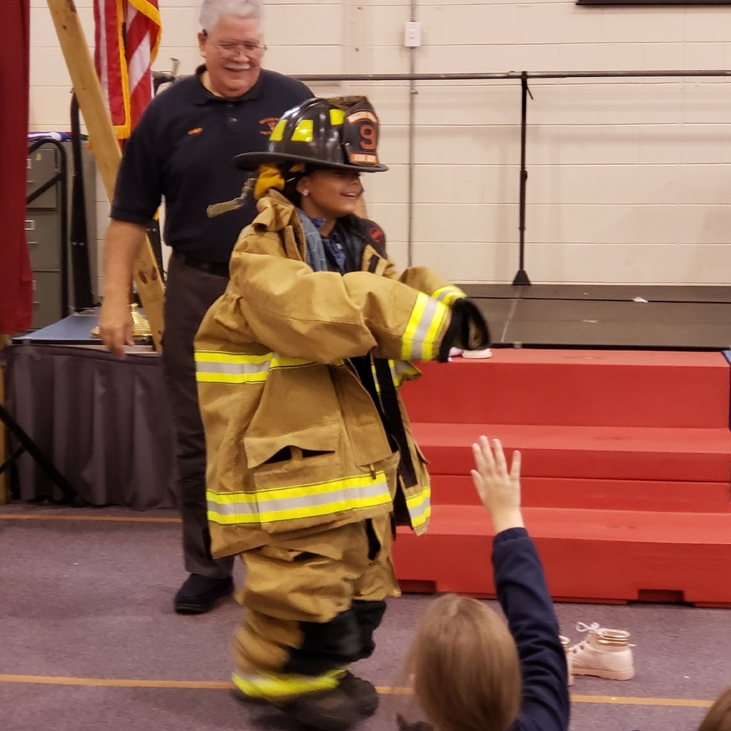 Nevaeh Lynch tries on turnout gear.