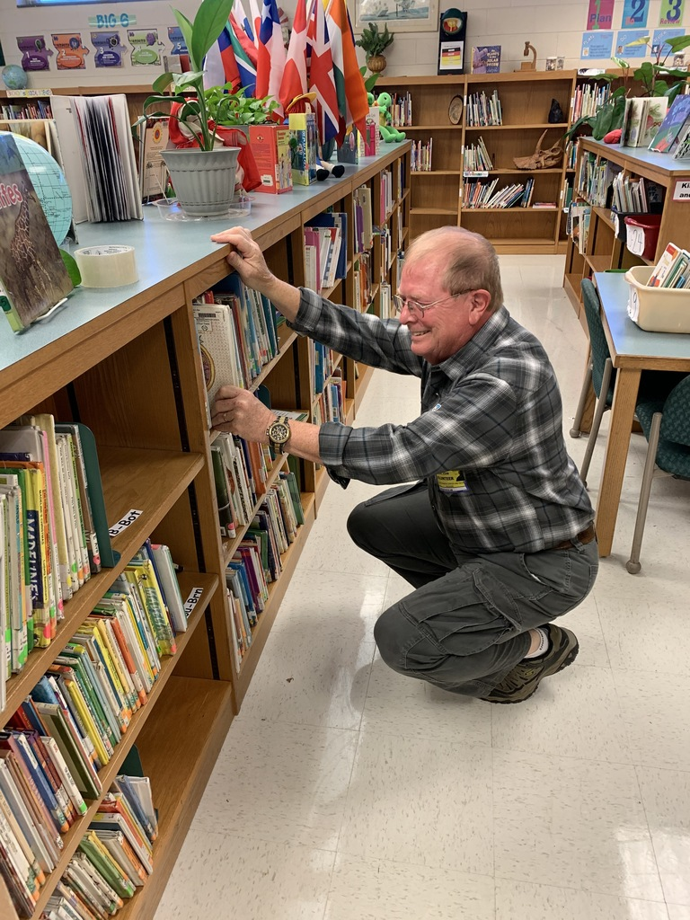 Volunteers helping get books back on the shelf!